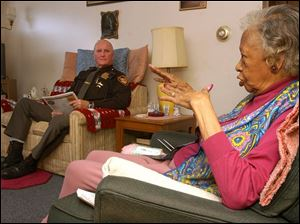 Special Deputy Bill Dickerson visits periodically with Lima resident Lady Alice Hurd during an 'Are You OK' visit.