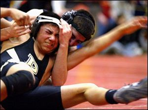Josh Sneyd of Waite gains control of Perrysburg's Justin Flores in