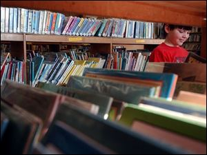 NBR fulrove04p B -- Jonathan Nawrocki, 10, enjoys time at the library in Delta. The Liberty Center fourth-grader was taking advantage of a school cancellation to play with puzzles Friday, 02/04/05. The Blade/Andy Morrison