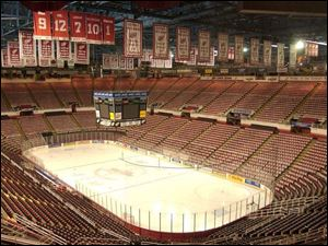 Joe Louis Arena, with banners signifying past glory, stands empty on the day the hockey season was officially canceled.