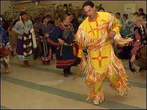 Juan Reiter of Cincinnati dances in an Apache outfit that honors his family&#