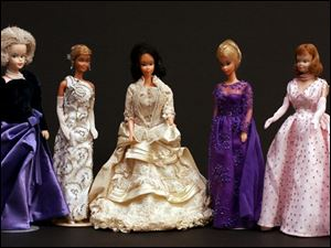 Barbie dolls are dressed to look like Barbara Bush, Nancy Reagan, Lucy Hayes, Hillary Clinton, and Mamie Eisenhower in a collection donated to the Hayes Presidential Center in Fremont.