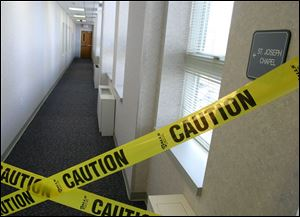 A hallway to the Mercy Hospital chapel, the 1980 crime scene, was taped off shortly after Father Robinson's arrest in April.
