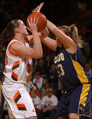 BG's Ali Mann shoots over Toledo's Savannah Werner on Saturday at Anderson Arena. The Falcons won in the last 10 seconds.