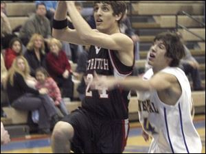 A.J. LaCourse of Cardinal Stritch drives past Continental's Scott Keck, but it was one of the few bright spots for Stritch.