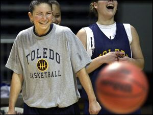 Amber Jacobs, left, and Danielle Bishop share a laugh in practice. Jacobs has helped the sophomore become Toledo's leading scorer.