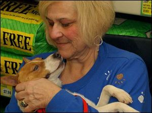 Pet psychic Anni Germani talks to one of the dogs at an