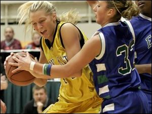 Northview s Lisa Johnson, left, tries to fight her way past