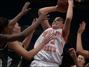 Ali Mann scores two of her team-leading 19 points yesterday at Gund Arena as Bowling Green defeated Eastern Mi
