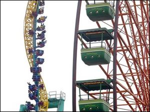 The owner of Cedar Point, home of the Wicked Twister, said the acquisition of Geauga Lake helped boost attendance.