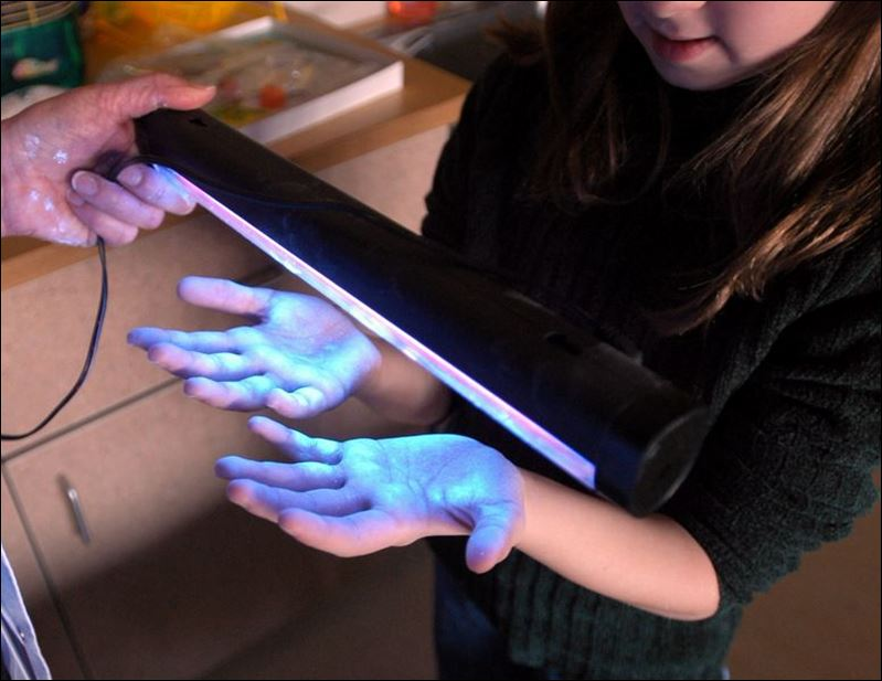Black light test on micaela lachapelle, 8, shows that her hands aren