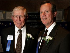 SIGHT SAVERS: Honoree Dick Anderson, left, and past honoree Jim Hoffman team up to save sight.