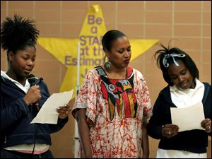 POETRY READING: Octavia McBride-Ahebee, center, shares her poetry with Shreeta Johnson, left, and Carmean Lewis, who are seventh-graders at Stewart girls' academy.