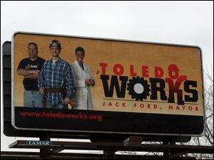 A Toledo Works billboard is located on the Anthony Wayne Trail north of the Toledo Zoo.