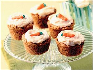 Hippity Hop Cupcakes combine the popular flavor of carrot cake with a hint of peanut butter. Top them with icing and frosting carrots.