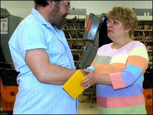 Corrine Martin thanks mail carrier Charles Blasingame at the West Toledo post office for assisting her ailing parents.