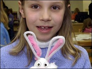 NBR  Metamora, Ohio.  hunt19p  Evergreen Community Library.  Taylor Monahan, 9, is proud of the bunny she made.  Diane Hires  3/19/05