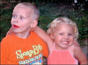 Five-year-old Dameatrius McCreary, shown with sister Breanna, 4, died after being struck by a car on Starr Avenue.