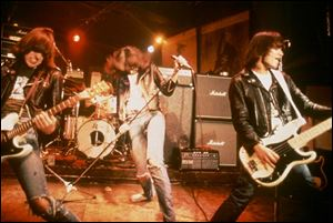 The Ramones perform in CBGB s, New York City s famous punk club, in 1977.