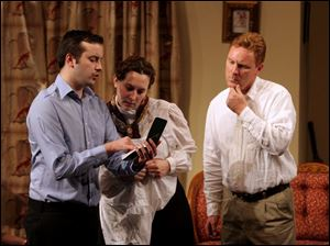 From left, Matthew Orser, Ruthann Huffman, and Bob Walls in a scene from The Mousetrap.