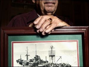 William O'Connor, a former Toledo Fire Department captain, was a medical corpsman on the attack transport USS Okanogan, above, during the Battle of Okinawa in 1945.