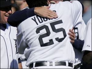 Dmitri Young gets a hug from Tigers manager Alan Trammell after his third home run.