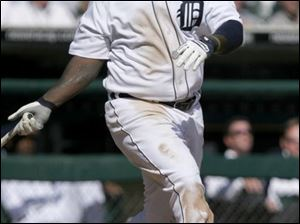 Dmitri Young, who was 4-for-4 with 5 RBIs, became the first Tiger to hit three home runs on opening day and the third player in major league history.