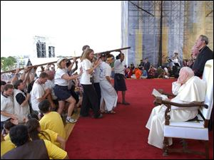 Pope John Paul II watches youths at World Youth Day in Toronto in 2002.