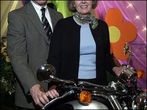 MOTORCYCLE MANIA: Dick and Lynn Baker inspect a motorcycle at the Gladieux event for Toledo Children's Hospital.
