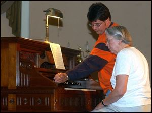 Reed organ restorer Casey Pratt, left, and composer Marcia Hendron at Fayette's popular Reed Organ Festival, May 2004.