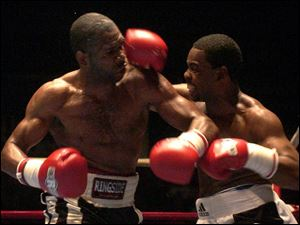 Dennis Draper, right, who debuted as a super middleweight Saturday night, is a Scott graduate with four children. Henry Mayes of Baltimore won a unanimous decision over Draper.