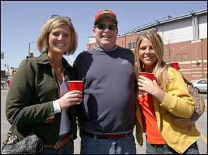 PARTY TIME: Britt Lock, left, Bob Douglas, and Mindy Hudson find that the parking lot is an excellent place for a party.
