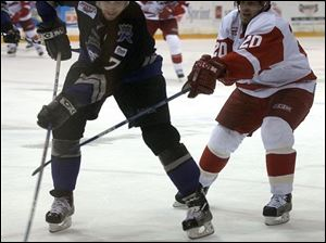 The Storm's Rick Judson fights for the puck with Reading's Reagan Rome.