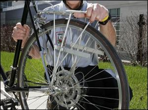 Larry Lindsay was in Toledo Thursday with his bike. He has gone across the United States twice.