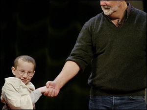 'Star Wars' creator George Lucas, right, greets 8-year-old Tyler Hamrick of Glen Burnie, Md.