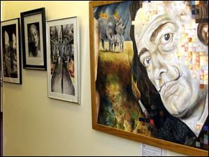 Steve Harris of Bowling Green has a closer look at one of the artworks, which were spread among more than 25 buildings.