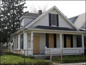 This house on Chicago Street in Toledo's near north side sold for 15 percent of Lucas County's estimate of its worth.