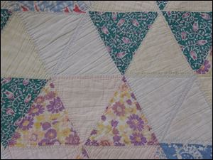 Detail from one of the quilts that will be part of the Sauder Village annual quilt fair that runs Tuesday