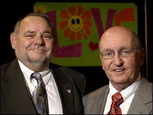 ALL YOU NEED IS LOVE: Bob McCloskey and Andy Kandik smile after receiving honors from the East Toledo Family Center.