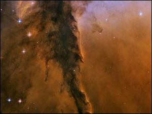 Scientists used the newer ACS camera to revisit one region of the eerie-looking Eagle Nebula, producing a new image with stunning detail. The image reveals a tall, dense tower of gas being sculpted by ultraviolet light from a group of massive, hot stars. The Eagle Nebula image was taken in November 2004.