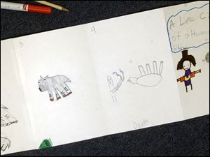 Third graders in Joe Sarnes class gave their impressions of a black rhino's life stages compared to humans.