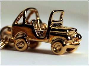 A Jeep charm such as this one at Broer-Freeman Jewelers may be a fun way to show civic pride.