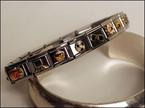 Modern charm bracelets such as this piece at David Fairclough