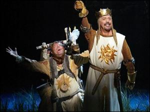 Michael McGrath plays Patsy, left, and Tim Curry is King Arthur in Monty Python s Spamalot.