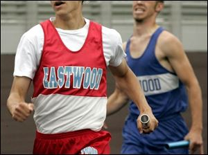 Eric Gerwin runs to victory for Eastwood in the 800 relay. The Eagles scored a school-record 193 points in the meet.
