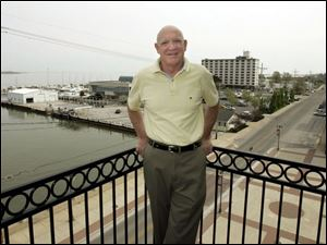 Dan Delahunt on a balcony at his downtown building, where six of the nine condos are to feature a view of Lake Erie.