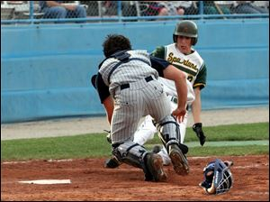 St. John s catcher Blake Haudan tags out Start s Jason Moulton on this play, but Moulton went 4-for-4 with three RBIs.