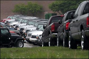 BIZ cars21p  Dodge Ram and Dodge Dakota pickups have joined other Chrysler vehicles, including Jeep Cherokees,  Jeep Wranglers, and Jeep Libertys, to  overflow the parking lots of the former North Towne Square in Toledo, Ohio on May 19, 2005. The Blade/Jetta Fraser