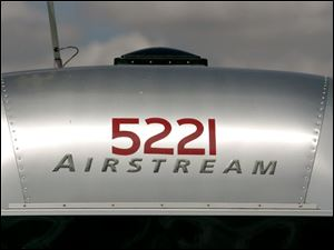 REG airstream25p 03 - The sleek Airstream look of the trailer is plentiful at the Sandusky County Fairgrounds gathering of the Region 4 airstream rally. The Blade/Allan Detrich