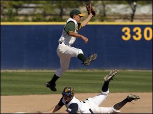 Whitmer's J.J. Fought steals second as Start's Ricardo Lizcano jumps for the throw.
